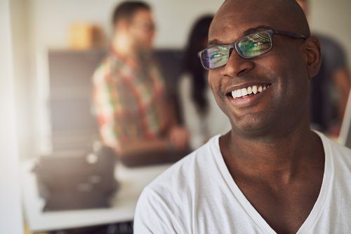16 shutterstock focus man smiling in glasses