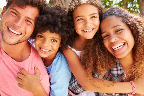 16 shutterstock happy mixed race family
