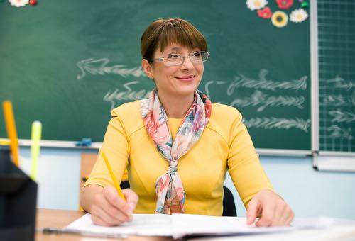 16 shutterstock teacher smiling happy web